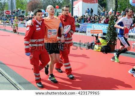 VIENNA, AUSTRIA - APRIL 10, 2016: Runner finishes with support the Vienna City Marathon , April 10, 2016 in Vienna, Austria. - stock photo