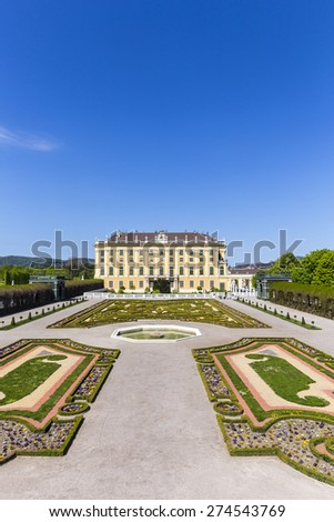 VIENNA, AUSTRIA - APRIL 24, 2015: Schonbrunn Palace with prince garden view in Vienna, Austria.  The former imperial summer residence is  Viennas most visited tourist attraction. - stock photo
