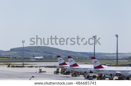 VIENNA, AUSTRIA ?? APRIL 30th 2016: Austrian Airline planes lined up a busy Saturday at Vienna International Airport.