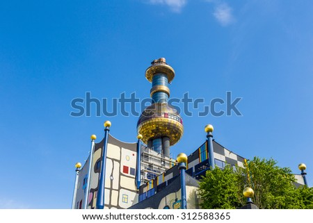 VIENNA, AUSTRIA - APRIL 28, 2015: Tower of Garbage-processing plant in Vienna, Austria. Designed by Friedensreich Hundertwasser. It was inaugurated in 1992 and heats 60000 apartments.