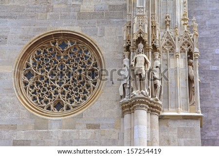 VIENNA, AUSTRIA - AUGUST 8 : A Rose Window (Catherine window) and Exterior detail at St. Stephen's Cathedral (Stephansdom) on August 8, 2012 - stock photo
