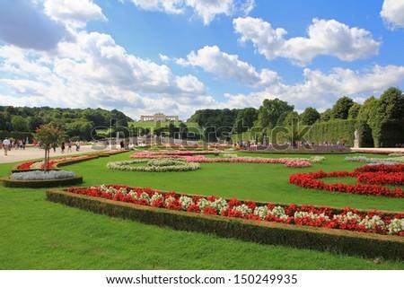 VIENNA, AUSTRIA - AUGUST 2012 : Beautiful garden and the Gloriette at Schloss Schoenbrunn Palace, A UNESCO World Cultural Heritage in Vienna - Austria on August 9, 2012. - stock photo