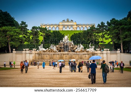 VIENNA, AUSTRIA - AUGUST 26, 2012: Beautiful gardens and Gloriette in the Schonbrunn garden, major historic and cultural landmark in the Vienna, the capital city of Austria, 26th of August, 2012. - stock photo