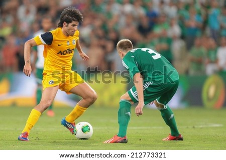VIENNA, AUSTRIA - AUGUST 8 Brian Behrendt (#3 Rapid) and Sebastian Grazzini (#10 Asteras) fight for the ball at a UEFA Europa League game on August 8, 2013 in Vienna, Austria. - stock photo