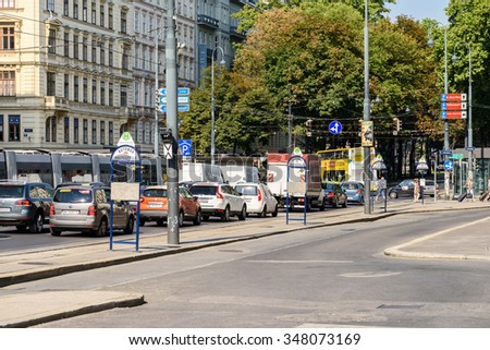 VIENNA, AUSTRIA - AUGUST 25, 2015: Busy Traffic And People On Downtown Streets Of Vienna City In Summer.