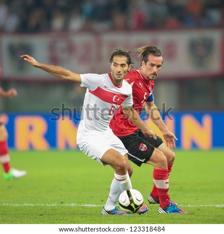VIENNA,  AUSTRIA - AUGUST 15 Christian Fuchs (#5 Austria) and Hamit Altintop (#6 Turkey) fight for the ball during the friendly soccer game on August 15, 2012 in Vienna, Austria.