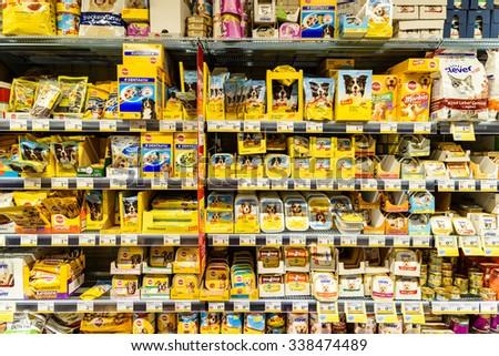 VIENNA, AUSTRIA - AUGUST 20, 2015: Dog Food Products For Sale On Animal Supermarket Shelf. - stock photo