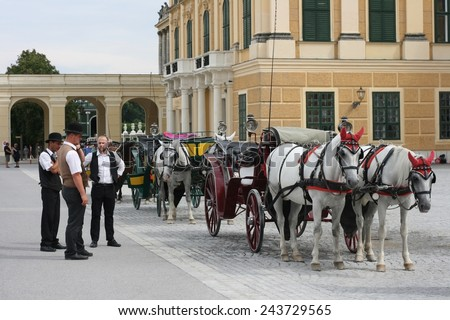 VIENNA, AUSTRIA - AUGUST 10, 2014: Horse carriage called the fiaker in front of the Schonbrunn palace in Vienna. Since the 17th century, these carriages characterize Vienna's cityscape. - stock photo
