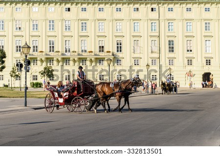 VIENNA, AUSTRIA - AUGUST 20, 2015: Horses and Classic Carriage Transport at Hofburg Palace the former imperial palace in the centre of Vienna. - stock photo