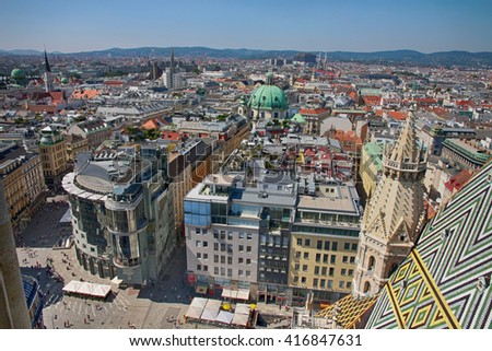 Vienna, Austria - August 19, 2012: Panorama of Vienna, aerial view from Stephansdom cathedral, Peoples on streets, urban life in Vienna, Austria on August 19, 2012. - stock photo