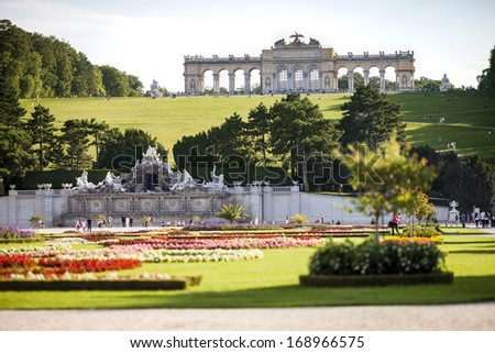 VIENNA, AUSTRIA - AUGUST 31, 2013; Schonbrunn Palace garden with Gloriette. This is very good place to see a view of the city Vienna, UNESCO; August 31, 2013 in Vienna, Austria.  - stock photo