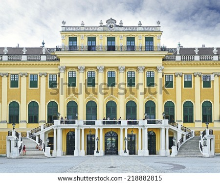 VIENNA, AUSTRIA - AUGUST 10: The facade of the Schonbrunn Palace with grand staircase on August 10, 2014.  Schonbrunn Palace is UNESCO World Heritage Site - stock photo