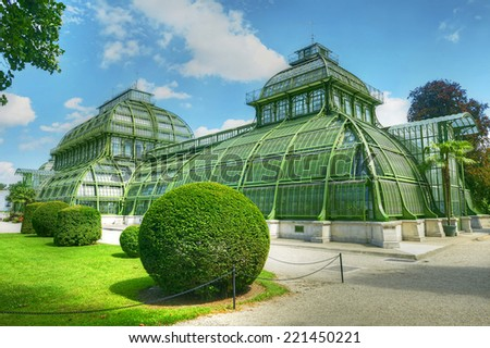 VIENNA, AUSTRIA - AUGUST 10: Tropical greenhouse - The Palm House in gardens around the Schonbrunn Palace on August 10, 2014. Schonbrunn Palace with its parks and gardens is UNESCO World Heritage Site - stock photo
