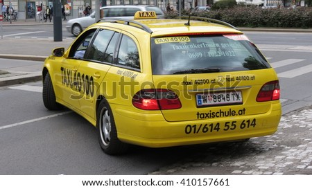 VIENNA, AUSTRIA - CIRCA APRIL 2016: yellow taxi in the very city centre of Vienna - stock photo
