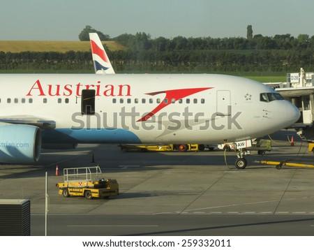 VIENNA, AUSTRIA - CIRCA JUNE 2012: Aircraft of the Austrian Airlines at the airport - stock photo