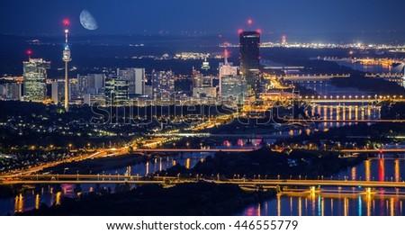 Vienna Austria City Skyline at Night. Danube River Bridges and Reflections.