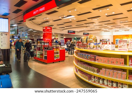 VIENNA, AUSTRIA - DEC 30, 2014: Duty Free secction of the Vienna International Airport, which serves as the hub for Austrian Airlines - stock photo
