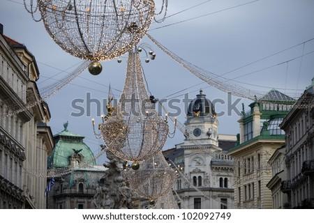 VIENNA, AUSTRIA - DECEMBER 09: famous Graben street by night on December 09,2011 in Vienna, Austria. The Graben traces its origin back to the old Roman encampment of Vindobona. - stock photo