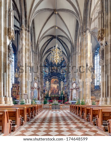 VIENNA, AUSTRIA - DECEMBER 24: St. Stephen's Cathedral interior on December 24, 2013 in Vienna. Built of limestone is 107 metres long, 40 metres wide, and 136 metres tall at its highest point. - stock photo