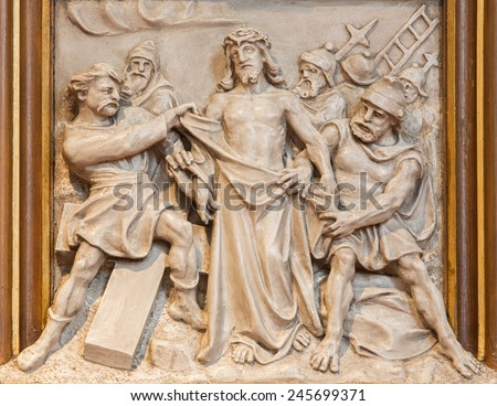 VIENNA, AUSTRIA - DECEMBER 17, 2014: The Jesus Stripped of His Garments relief as one part of Cross way cycle in Sacre Coeur church by R. Haas from end of 19. cent.