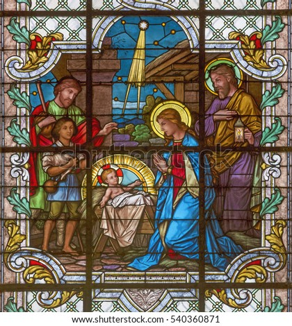 VIENNA, AUSTRIA - DECEMBER 19, 2016: The Nativity scene on the stained glass of church Mariahilfer Kirche by prof. Rudolf Geyling (1897) in workroom Carl Geylings Erben.