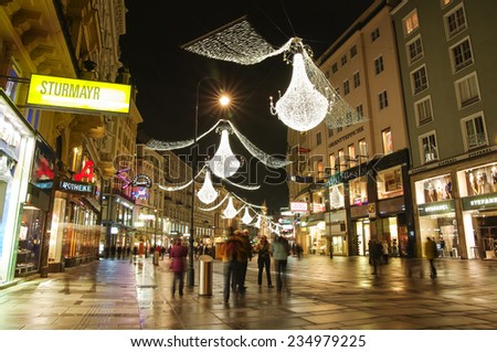 VIENNA, AUSTRIA - December 11, 2009: Vienna - tourists on famous Graben street at night with Christmas chandeliers in Vienna, Austria. on December 11, 2009