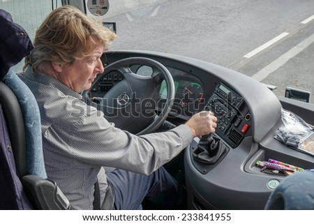 VIENNA, AUSTRIA/EUROPE - SEPTEMBER 22 : Coach driver working in Vienna on September 22, 2014.Unidentified man.