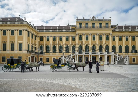 VIENNA, AUSTRIA/EUROPE - SEPTEMBER 23 : Horses and carriages at the Schonbrunn Palace in Vienna Austria on September 23, 2014. Unidentified people. - stock photo