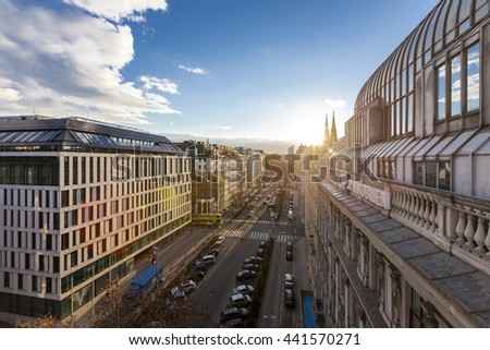 VIENNA, AUSTRIA - FEBRUARY 11, 2016: Aerial View of the Kolingasse of Vienna with the famous Votive Church in the background at sunset - stock photo