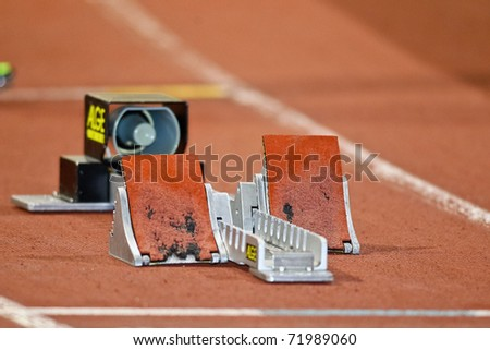 VIENNA, AUSTRIA - FEBRUARY 19: Indoor track and field championship. Empty starting blocks at an indoor track and field event on February 19, 2011 in Vienna, Austria. - stock photo