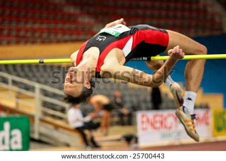 VIENNA, AUSTRIA - FEBRUARY 21: Indoor track and field championship: Guenther Gasper places third in the men's high jump event February 21, 2009 in Vienna, Austria. - stock photo