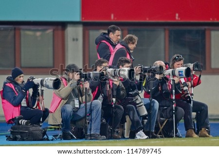 VIENNA, AUSTRIA - FEBRUARY 18 Photographers on the sideline during the soccer game on February 18, 2012 in Vienna, Austria. The game between Rapid and Austria ends 0:0. - stock photo