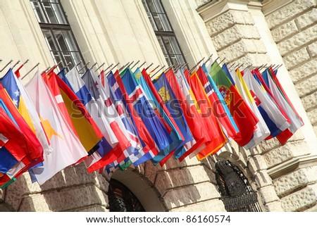 Vienna, Austria - international set of flags on Hofburg palace - stock photo