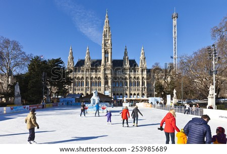 VIENNA, AUSTRIA - JANUARY 31, 2015: Ice skating people at the Wiener Eistraum (ice rink). The town government establishes every winter an ice rink in front of the Viennese city hall. - stock photo