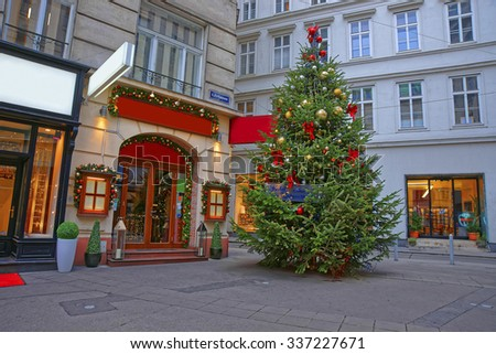 VIENNA, AUSTRIA, JANUARY 8, 2014: Street and Christmas tree with a modern design decoration in downtown of Vienna in Austria