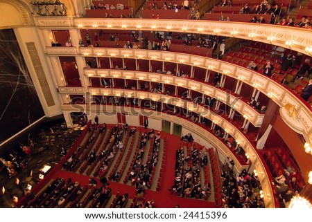 VIENNA, AUSTRIA - JANUARY 2:  Viena State Opera house interior before first performance of the year the Nutcracker ballet on January 2, 2009 in Vienna, Austria. The event brought out a multinational audience to see the performance. - stock photo