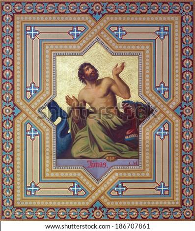 VIENNA, AUSTRIA - JULY 27, 2013: Fresco of prophet Jonah by Carl Mayer from 19. cent. in Altlerchenfelder church. - stock photo