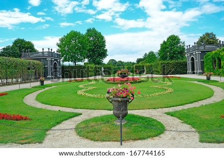 VIENNA, AUSTRIA -JULY 31: Garden of Schonbrunn Palace on July 31, 2013 in Vienna, Austria.  It was listed as a UNESCO World Heritage Site in 1996. - stock photo