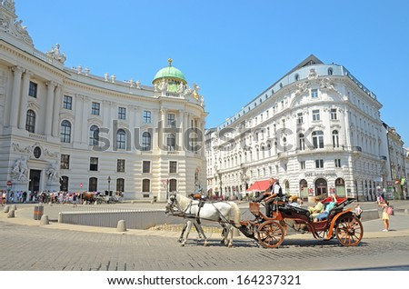 VIENNA, AUSTRIA - JULY 28: Hofburg palace on July 28, 2013 in Vienna, Austria. The Hofburg is the imperial palace of the Habsburg rulers in Vienna, consisting of over 2500 rooms. - stock photo