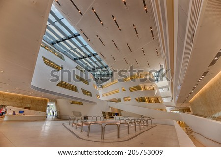 VIENNA, AUSTRIA - JULY 18, 2014: Interior of the new and futuristic Vienna University of Economics and Business. It is placed near Vienna Prater and designed by famous architect Zaha Hadid. Hdr image. - stock photo