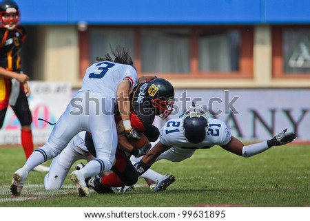 VIENNA, AUSTRIA - JULY 16 RB Jerome Morris (#31 Germany) is tackled at the Football World Championship on July 16, 2011 in Vienna, Austria. - stock photo