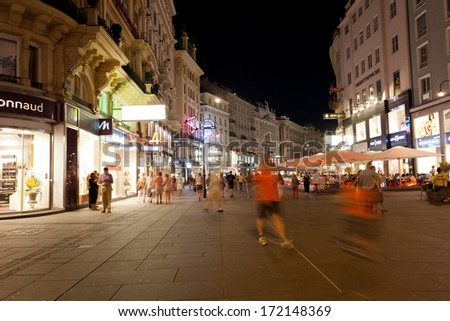 VIENNA, AUSTRIA - JULY 26,2013. Tourists walk at night in center of Vienna, Austria, July 26,2013. population of Vienna makes 1,68 million people, Vienna is  largest on  population the city of Austria