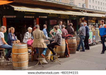 VIENNA, AUSTRIA - JUN 6, 2013: Coffee and wine break at popular outdoor cafe with drinking people on June 6, 2013. Vienna city has population near 1.8 million
