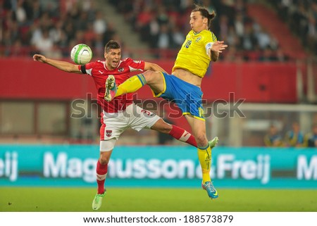 VIENNA,  AUSTRIA - JUNE  7 Aleksandar Dragovic (#3 Austria) and Zlatan Ibrahimovic (#10 Sweden) during the world cup qualifier game on June 7, 2013 in Vienna, Austria. - stock photo