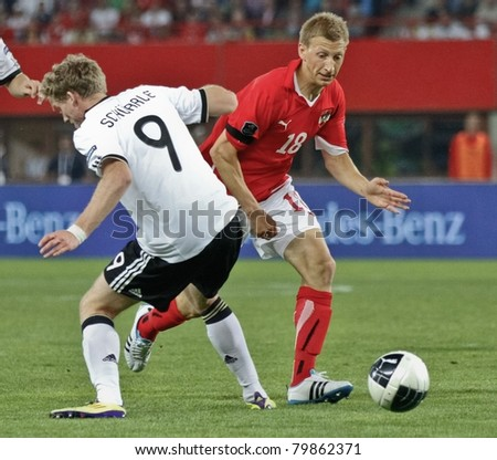 VIENNA,  AUSTRIA - JUNE 3 Andre Schuerrle (#9, Germany) and Daniel Royer (#18, Austria) fight for the ball during the EURO 2012 soccer game on June 3, 2011 in Vienna, Austria. Austria loses 1:2