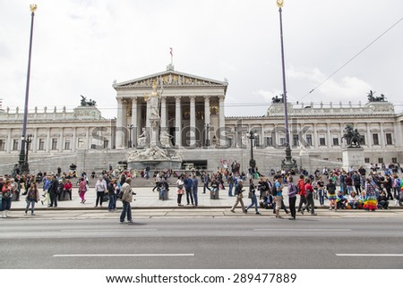 Vienna, Austria - June 20, 2015: Lesbian, gay and transgender people celebrate their event on the Ringstrasse of Vienna for solidarity, acceptance and equality. - stock photo