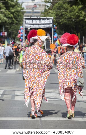 Vienna, Austria - June 18, 2016: Lesbian, gay and transgender people celebrate their event on the Ringstrasse of Vienna for solidarity, acceptance and equality. - stock photo