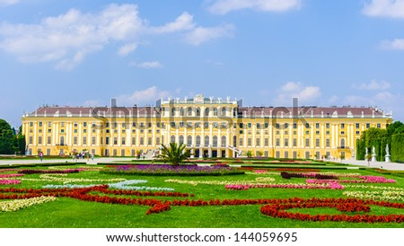 VIENNA, AUSTRIA - JUNE 17: Schonbrunn Palace and gardens on June, 17, 2013 in Vienna, Austria. It's one of the most important cultural monuments and one of the major tourist attractions in Vienna. - stock photo