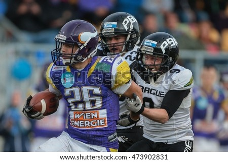 VIENNA, AUSTRIA - JUNE 20, 2015: WR Stanislav Jantos (#9 Panthers) tackles RB Miroslav Stankic (#26 Vikings)  in a game of the Austrian Football League.