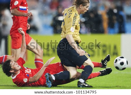 VIENNA, AUSTRIA - JUNE 26:  Yuri Zhirkov of Russia (l) challenges Fernando Torres of Spain (r) during a UEFA Euro 2008 soccer match June 26, 2008 in Vienna, Austria.  Editorial use only. - stock photo